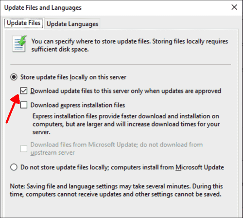 By default, WSUS only downloads the files for approved updates